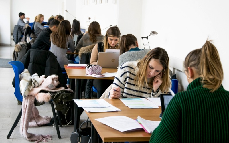 students studying in the study hall in Santa Chiara