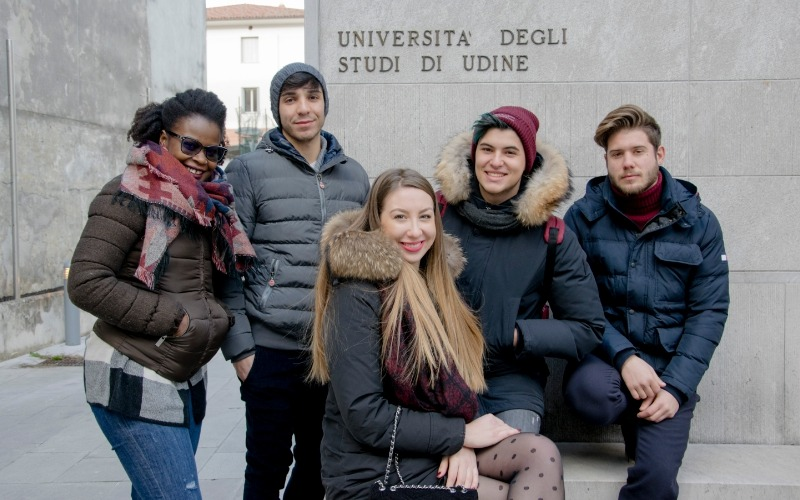 group of students standing outside the headquarter of Santa Chiara